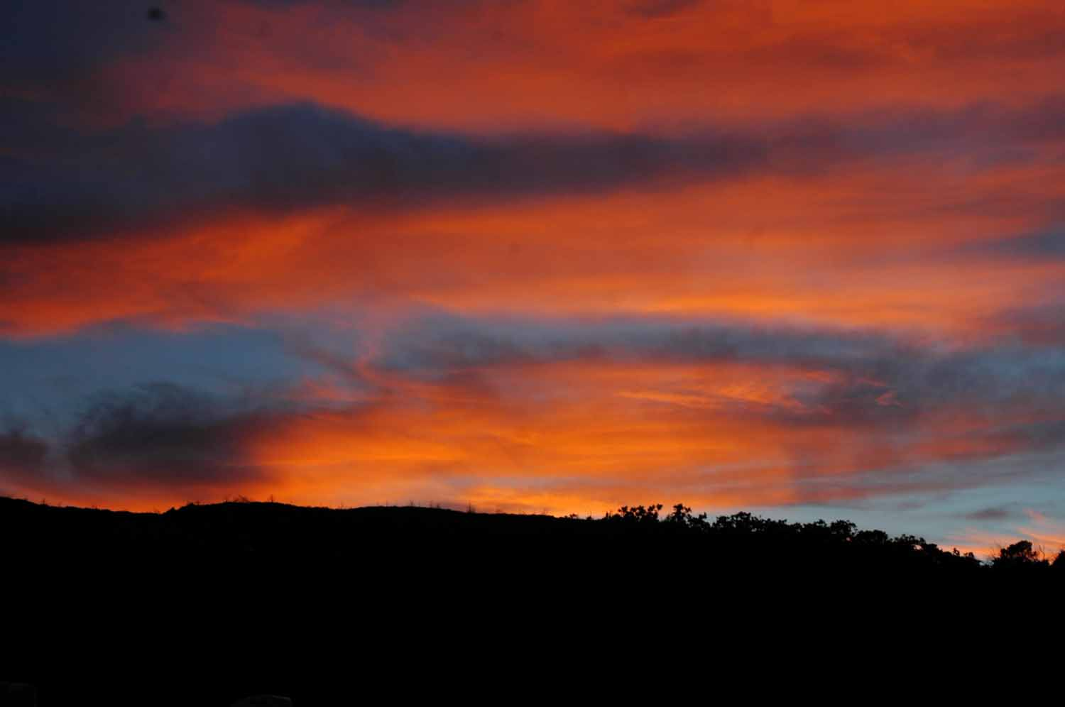 Not many good sunsets...this one was at the RV park Mesa Verde - Sun going down behind the mountain