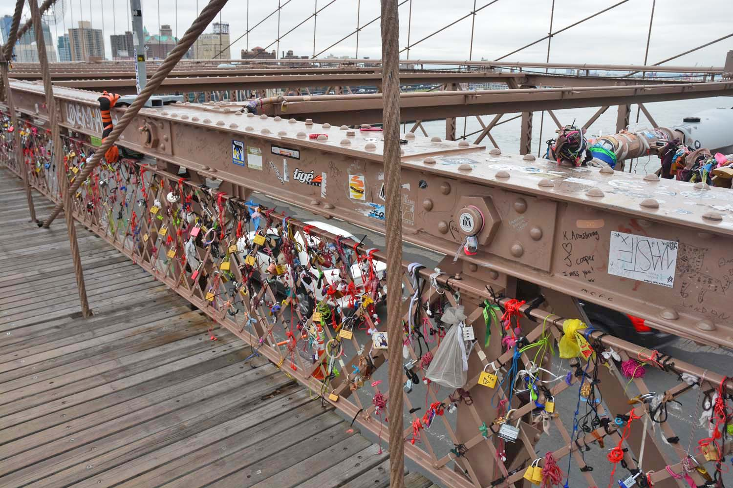 Brooklyn Bridge walk - Padlocks on bridges symbolize love with couples names enscribed
