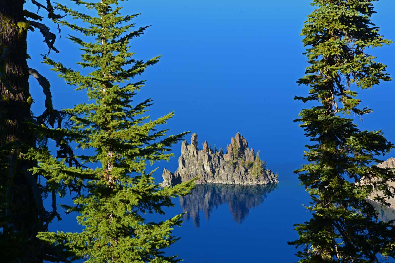 This rock formation in Crater Lake is called the Phantom Ship.  Would you believe it is over 12 stories tall above the water.  It too was created by a volcanic eruption.