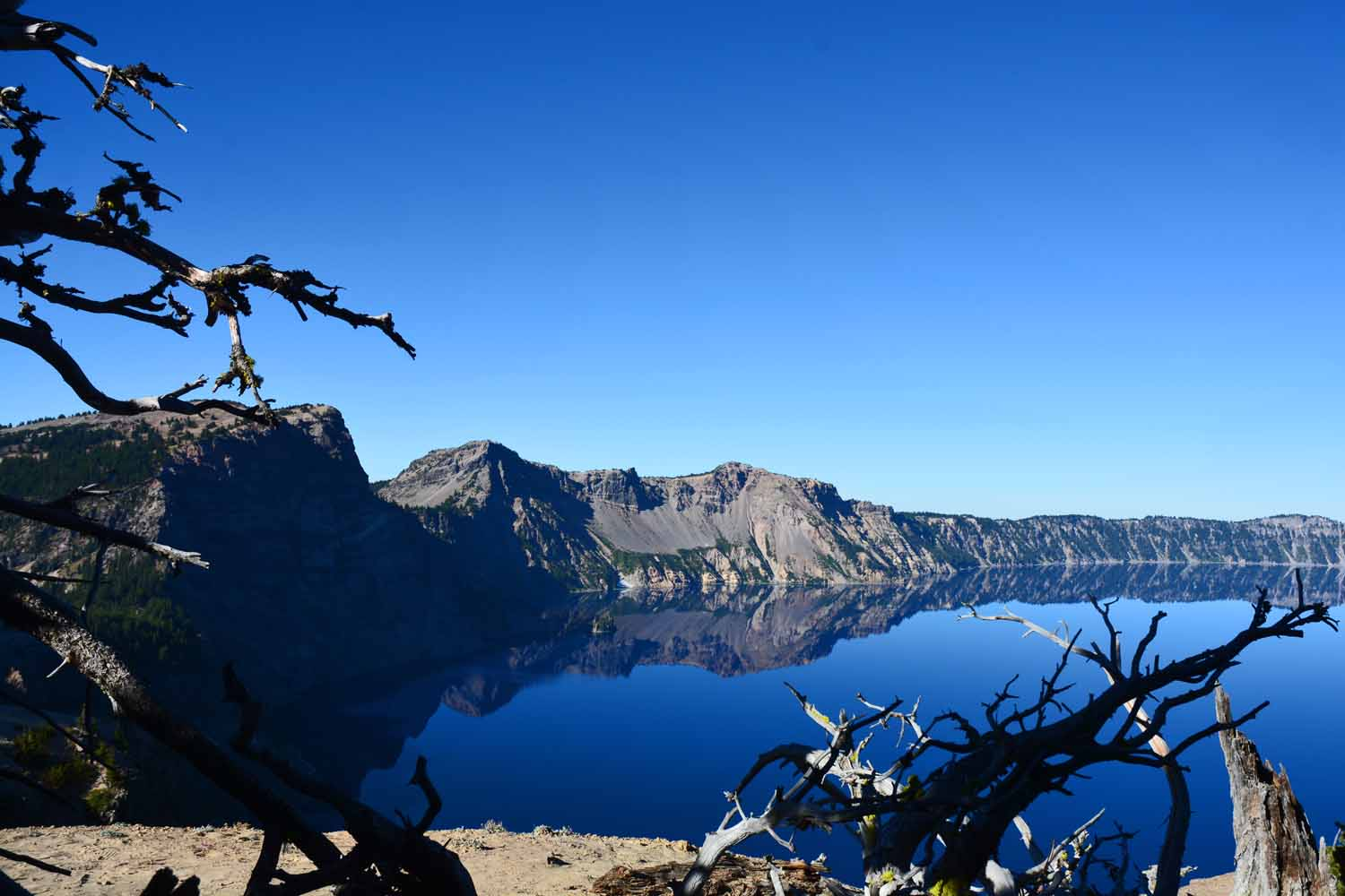 Crater Lake gets its blue color from the clear water.  There is little erosion running into the lake.  The two days we were there it was sunny and very little wind.