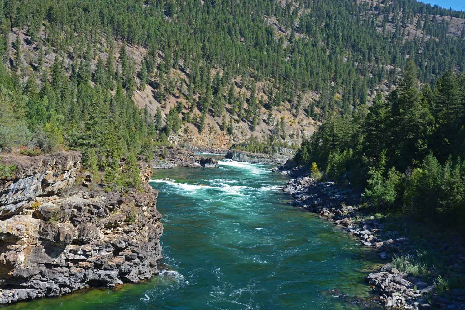 Kootenai River comes cown from Canada.  The water is still blue green.