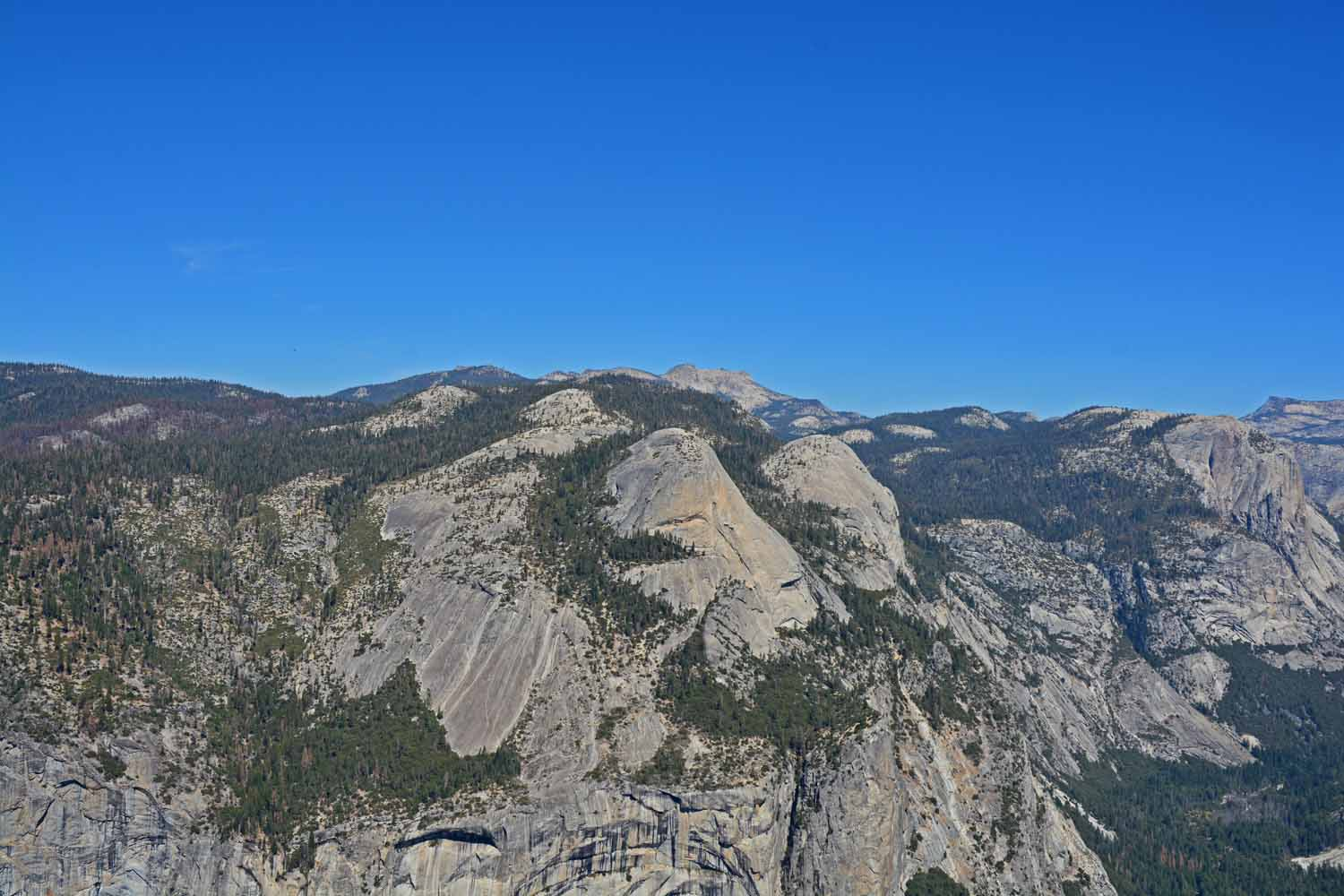 View from Glacier Point looking across the top of the mountains.