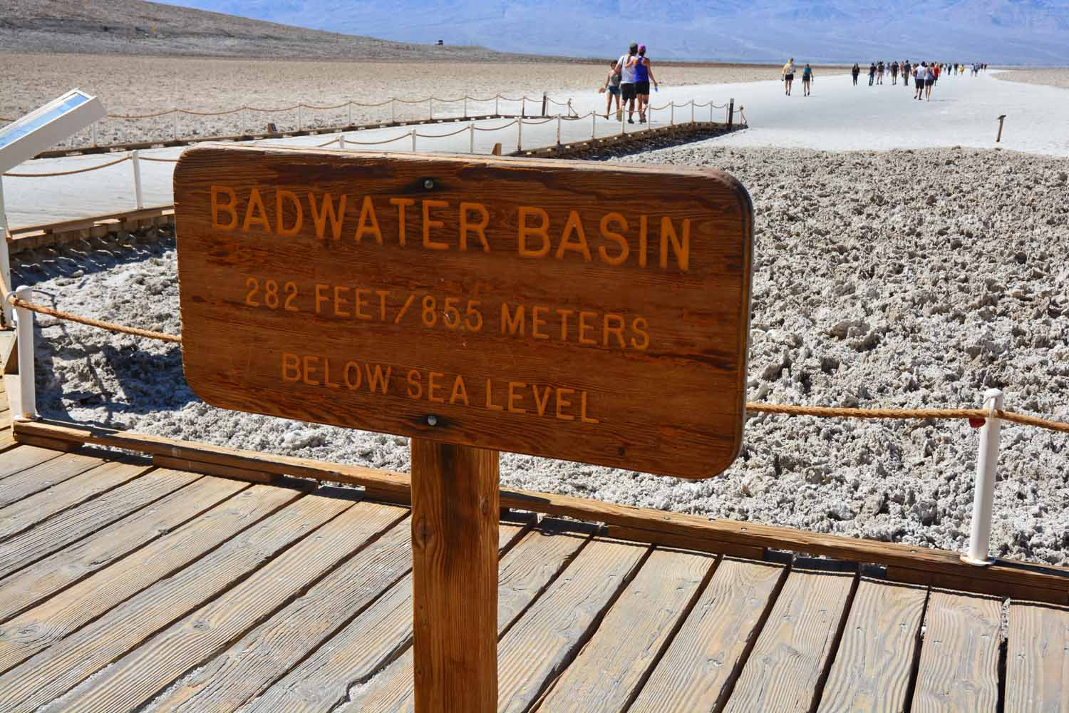 In the salt flats at Badwater Basin you are below sea level.  Actually the sediment here from the mountain run off over time is over 12,000 ft deep.  This depression is due to volcanic activity.  Per the curation the area is getting ready for another eruption.  We had lots of company on our walk out to the flats.