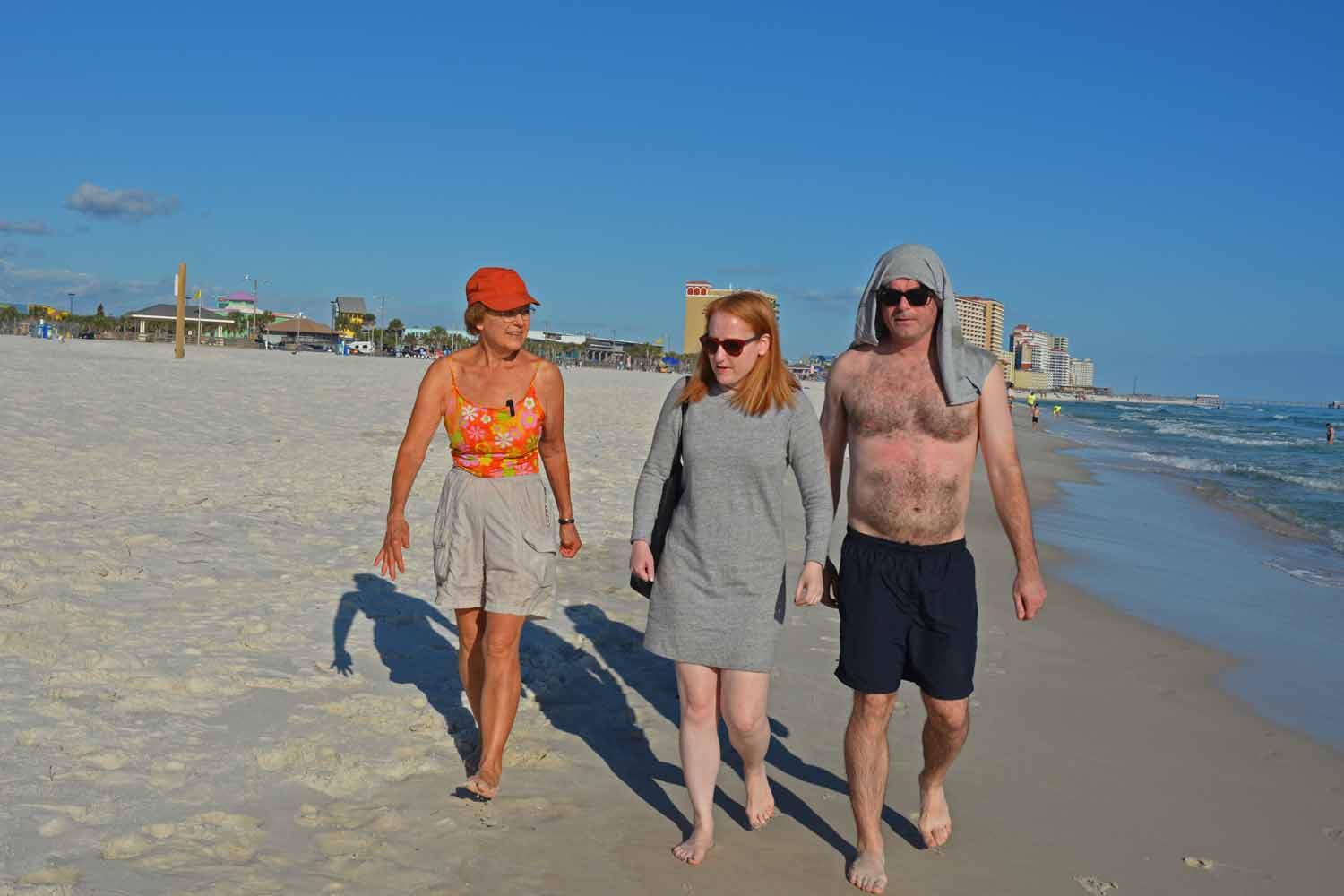 Jan, Fiona and John taking a stroll on the Gulf Coast of course Larry is always behind the camera