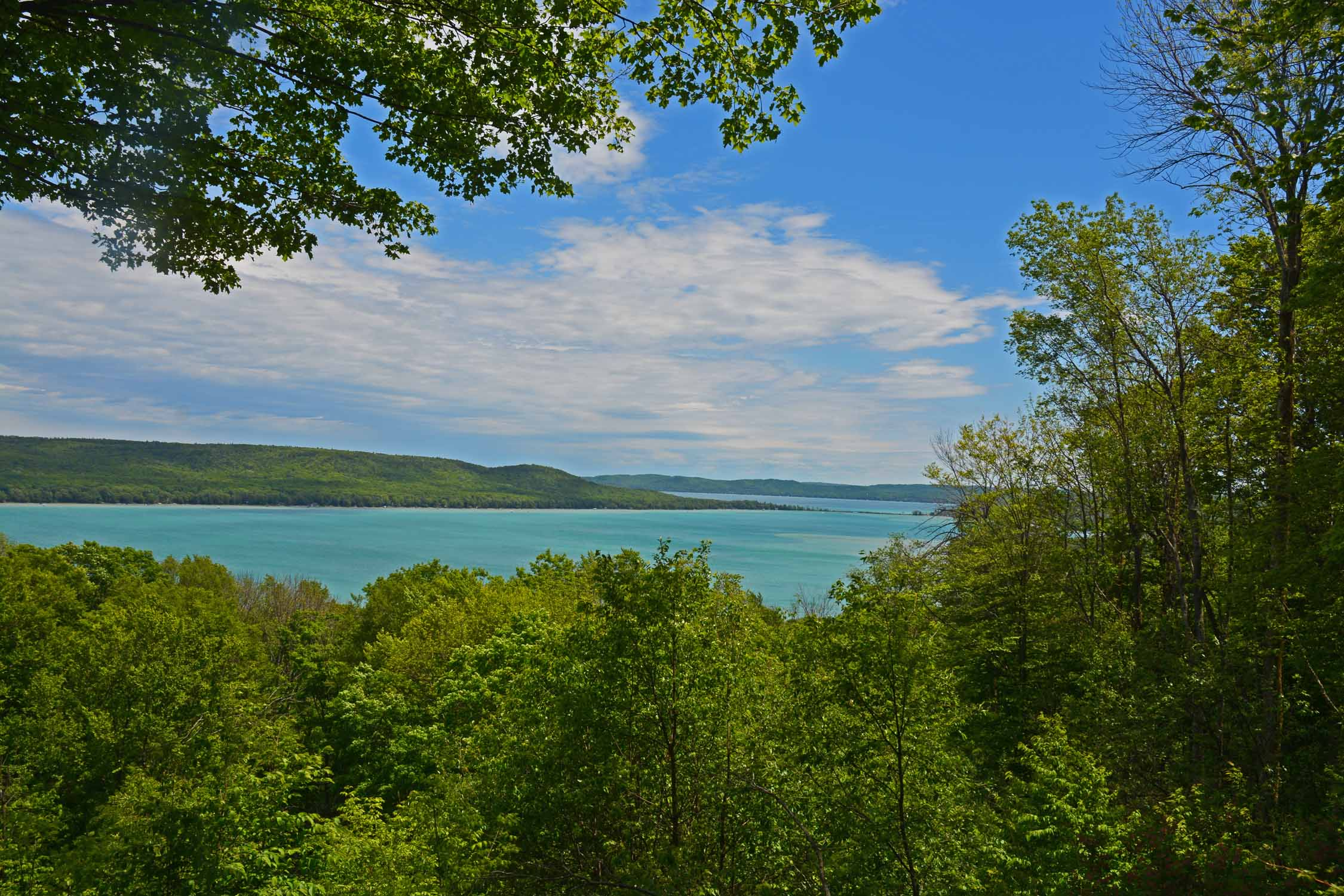 A stop at Sleeping Bear National Park demands a drive on the Stocking Memorial Drive.  Viewing the color of Glen Lake is one of the drives many rewards!